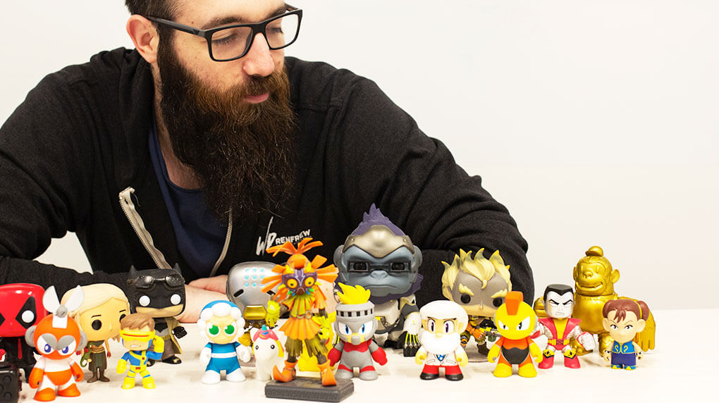 Darren Maher Creative Director at Major Tom and playing figures