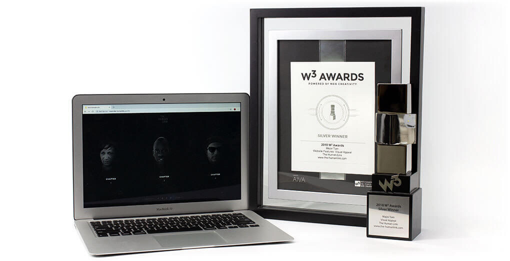 W3 Awards trophy opened laptop and the certificate