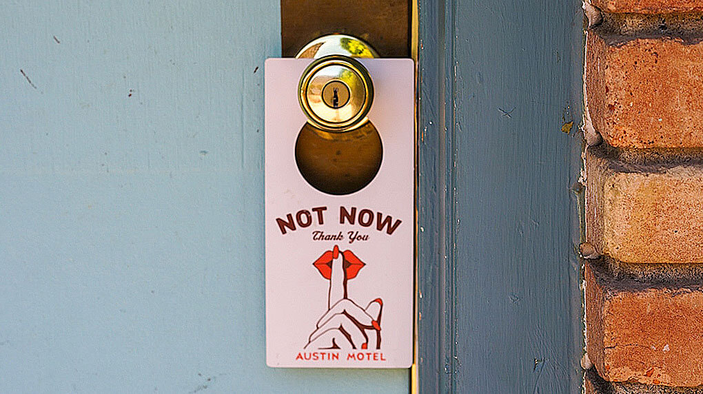 do not disturb hotel door sign