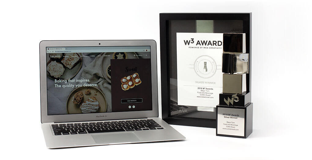 W3 Awards trophy opened laptop with Cobsbread website lodaed and the certificate