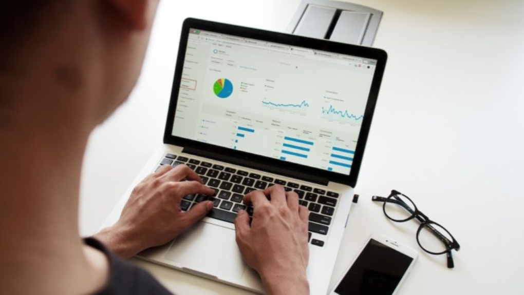person viewing dashboard filled with data on laptop