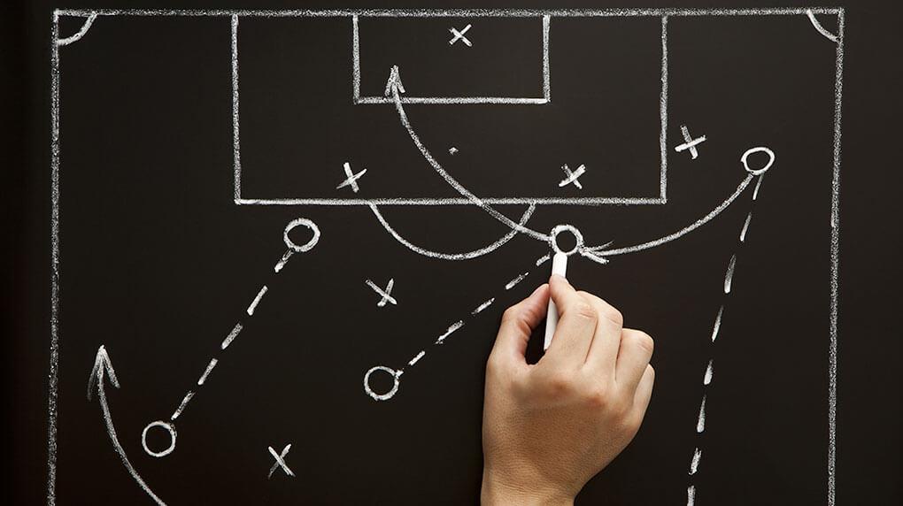 """drawn out game plan on blackboard"""