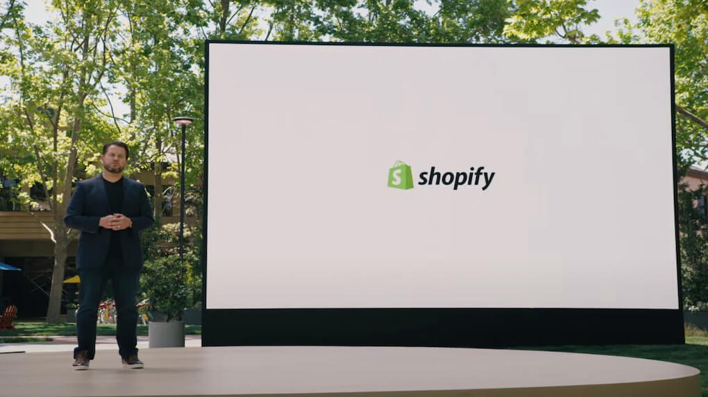 man presenting with shopify logo on screen