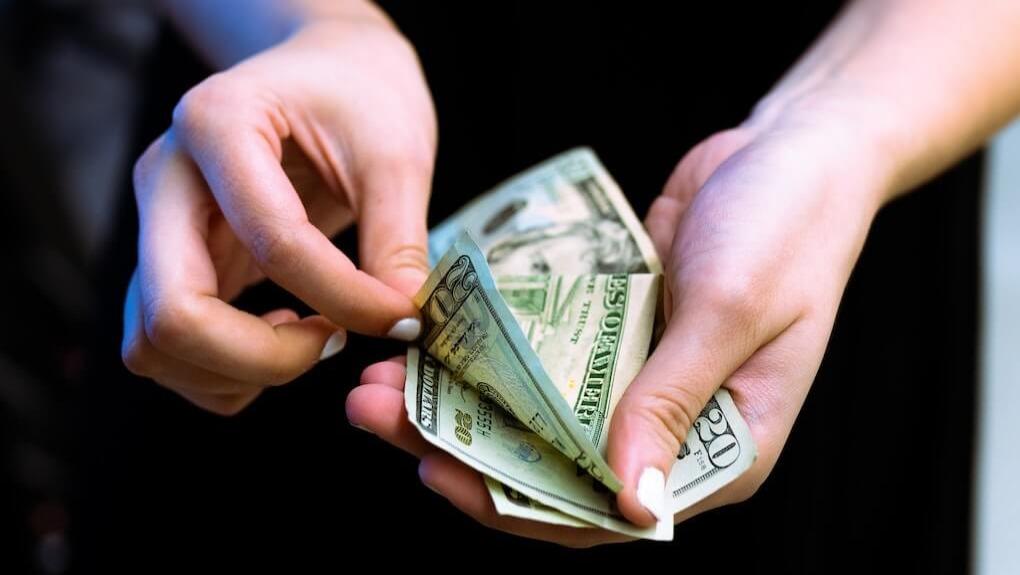 person holding cash money