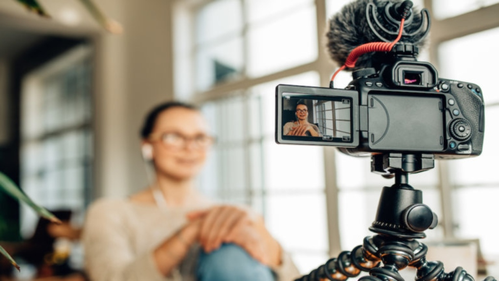 women filming herself with camera