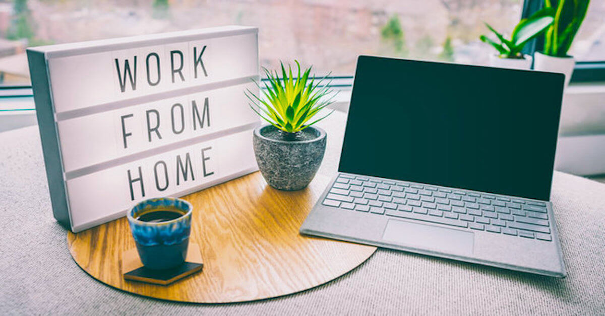 work from home light up box on desk next to laptop